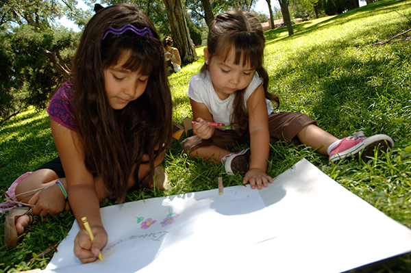 children coloring outside